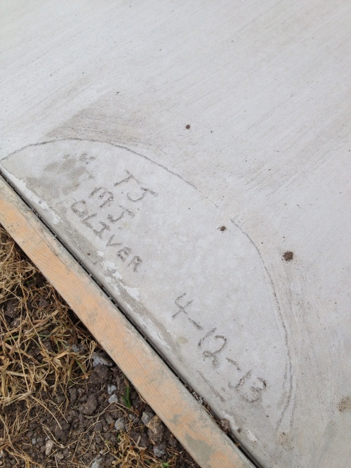 Michael was home the day they poured the concrete and wrote our initials and the date!