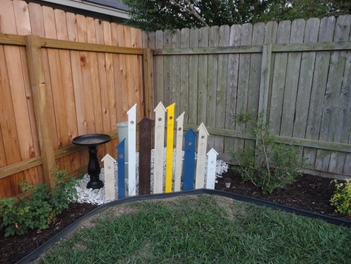 This was inspired by a pin on Pinterest. The hubs built it and I painted it. I love the fun splash of color it adds!